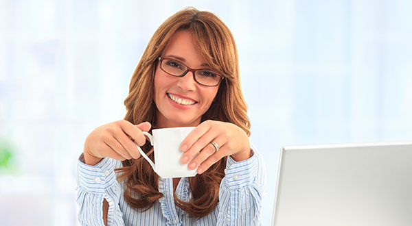 Smiling woman holding a coffee mug